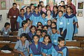 The First lady of USA, Ms. Laura Bush with students in a classroom run by 'Prayas' for exploited girls and rehabilitated vulnerable youth, in New Delhi on March 2, 2006.jpg