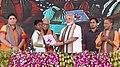 The Prime Minister, Shri Narendra Modi felicitating the beneficiaries of various schemes, at a function, in Varanasi, Uttar Pradesh.jpg