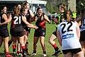 The RMIT Women's Football Academy Redbacks celebrate a goal at Bundoora Oval.jpg