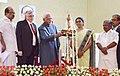 The Vice President, Shri M. Hamid Ansari lighting the lamp at the inauguration of the 4th phase of the Vidyadhanam project, at Kochi, Ernakulam, in Kerala.jpg