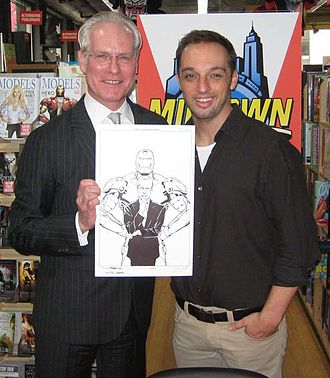 Phil Jimenez - Jimenez with Tim Gunn at Midtown Comics Times Square in Manhattan, for the September 9, 2009 signing of Models, Inc., the first issue of which features Jimenez's illustration of Gunn on the cover, the art for which Gunn is holding in the photo