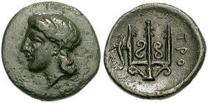 "Troezen - Coin (chalkous) from Troezen,325-300 BC. Obverse: Head of Athena wearing tainia. Reverse: Ornate trident head; to left, dolphin upward, ΤΡΟ(ΙΖΗΝΙΩΝ) ""of Troizenians""."