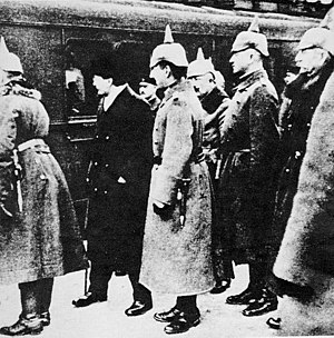 Soviet delegation with Leon Trotsky greeted by...