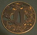 Tsuba from matching seven-piece set of sword fittings with scenes from The Tale of Heike.JPG
