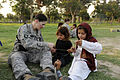 U.S. Army Capt. Alison Salerno, a physician's assistant with the 1st Brigade Special Troops Battalion, 101st Airborne Division, helps Afghan Girl Scouts make friendship bracelets during a Girl Scout meeting 100821-F-FW394-125.jpg