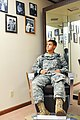 U.S. Army Pfc. Johnathen O'Neill, a cook with the 854th Engineer Battalion, sits in a barber chair at Fort Chaffee, Ark., July 23, 2013 130723-A-KC567-002.jpg