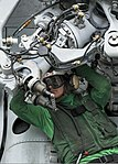U.S. Navy Aviation Structural Mechanic 3rd Class Michael B. Herring performs maintenance on an MH-60R Seahawk helicopter assigned to Helicopter Maritime Strike Squadron (HSM) 75 on the flight deck of 130817-N-UV347-268.jpg