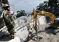 U.S. Navy Gunner's Mate 2nd Class Timothy Gandini, attached to Naval Mobile Construction Battalion 7 out of Gulfport, Miss., spots for heavy machinery operators at the site of the Hotel Montana in 100313-N-HX866-007.jpg