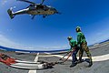 U.S. Navy Logistics Specialist Seaman Nick Fleming, left, and Logistics Specialist 3rd Class Kyle Shy attach cargo legs to an MH-60S Seahawk helicopter assigned to Helicopter Sea Combat Squadron (HSC) 25 on 131115-N-ZS026-238.jpg