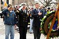 U.S. Navy Rear Adm. Patrick J. Lorge, center, the commandant of Naval District Washington, renders a salute alongside Pearl Harbor survivor Frank Yanick Sr., left, and retired Navy Cmdr. Paul Stillwell 121207-F-ZE674-107.jpg