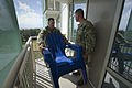 U.S. Navy Steelworker 1st Class Terryl McCormack, left, and Equipment Operator 2nd Class Shawn Pidsadnick, both assigned to 20th Seabee Readiness Group, remove items from residents' patios at the Armed 120828-N-PC102-097.jpg