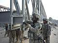 U.S. servicemembers reassemble the Saracha Bridge.jpg