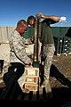 U. S. Marine Lance Cpl. Trevor Woodyard (left) and Cpl. Calab Brintnall with Combat Logistics Regiment 2, 2nd Marine Logistics Group, count ammunition at an ammunition holding area during Enhanced Mojave Viper 120912-M-KS710-018.jpg