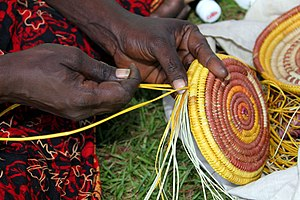 Australian Aboriginal fibrecraft - Christine Owney, a Jawoyn tribe resident of the Manyallaluk/Eva Valley community, weaves a basket from pandanus