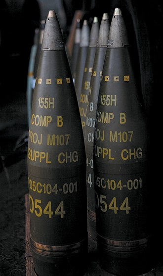 "TNT - M107 artillery shells. All are labelled to indicate a filling of ""Comp B"" (mixture of TNT and RDX) and have fuzes fitted"