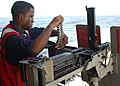 US Navy 020523-N-6913J-001 Gunner's Mate Loads 50 Caliber Machine Gun.jpg