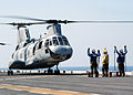US Navy 021107-N-4374S-025 CH-46 prepares to lift-off.jpg