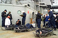 US Navy 030205-N-8935H-006 Simulated personnel casualties lie in stretchers at a medical triage area on the ship's main deck following a Force Protection Small Boat Attack drill.jpg