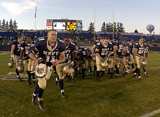 Bowl eligibility - The 2003 Navy Midshipmen football team leaving the field after their seventh win of the season, assuring them bowl eligibility.
