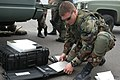 US Navy 040407-N-8937A-117 Operation's Specialist 2nd Class David Ward, assigned to Explosive Ordinance Disposal Mobile Unit Five (EODMU-5), Detachment 51, processes x-ray photographs of a suspected explosive device taken durin.jpg
