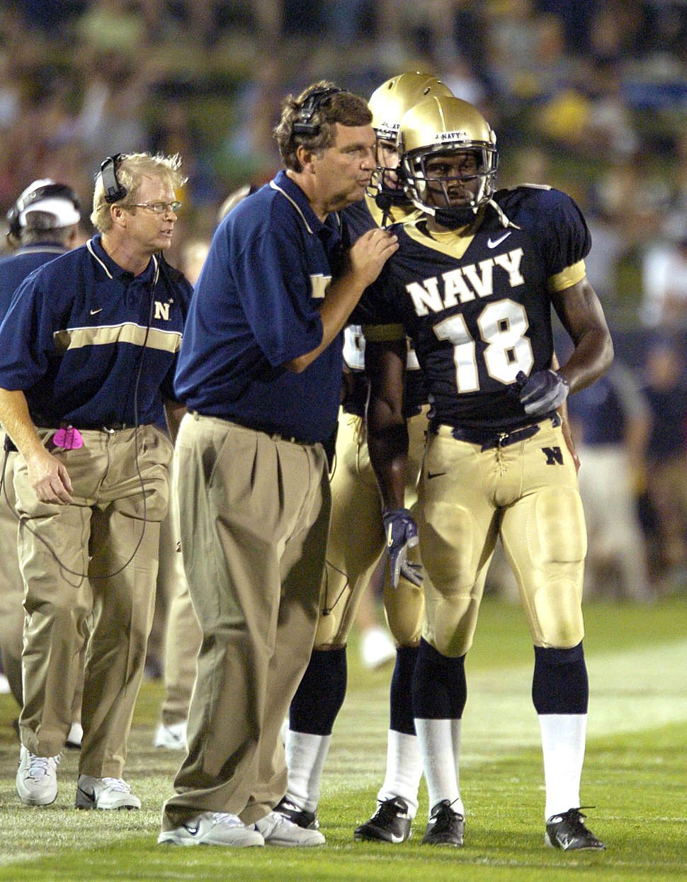 US Navy 040904-N-9693M-010 U.S. Naval Academy football team head coach Paul Johnson sends the teams next play in with Midshipman 1st Class Lionel Wesley