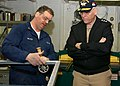 US Navy 041104-N-7130B-055 Aviation Structural Mechanic 2nd Class Marshall Milton of Slidell, La., explains his job to Deputy Chief of Naval Operations for Fleet Readiness and Logistics, Vice Adm. Justin McCarthy.jpg