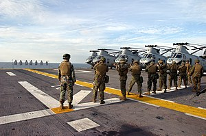 Marines - U.S. Marines conducting a live fire training exercise aboard an amphibious assault ship.