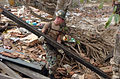 US Navy 050116-M-3295H-036 Builder 2nd Class Cortland W. Hurst assigned to Naval Mobile Construction Battalion Seven (NMCB-7), recover useable pieces of lumber from the badly damaged Ahangama Primary School in Ahangama, Sri Lan.jpg