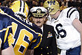 US Navy 050403-N-2115M-168 Commanding Officer, Naval Station Everett, Capt. Eddie Gardiner, shakes hands with players of the National Indoor Football League during Military Appreciation Night at the Everett Events Center, Evere.jpg