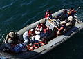 US Navy 050430-N-5526M-028 Sailors transfer men and women in a rigid hull inflatable boat after their boat, a fishing vessel, capsized 25 miles off the coast of Somalia.jpg