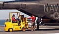 US Navy 050907-N-6125G-144 U.S. Navy Aviation Ordnancemen unload supplies from an MH-53E Sea Dragon helicopter.jpg