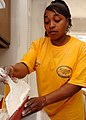 US Navy 060306-N-5345W-069 Operations Specialist 2nd Class Chandra Waters begins to spackle the kitchen walls in a Gulfport home, while preparing the interior for repainting.jpg