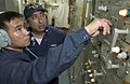 US Navy 060907-N-9851B-003 Electrician's Mate Fireman Rafael Campano simulates the control of an electrical switch board under the supervision of Gas Turbine Systems Technician Electrical 1st Class Victor Ponce.jpg