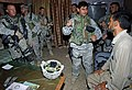 US Navy 061003-N-4097B-002 U.S. Army Soldiers talk to an Iraqi man at an Iraqi police station prior to conducting a search and seizure for insurgents in a village outside Baqubah, Iraq.jpg