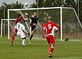 US Navy 070119-N-6645H-002 The All-Navy men's soccer team starting goalkeeper, Mass Communication Specialist 3rd Class Ian Elias, goes up for a save during a match against the Marines held at Patton Park.jpg