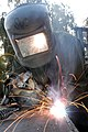 US Navy 070125-N-1625W-003 Steelworker 1st Class Brian Hunt of Bremerton, Wash., welds together pieces of steel to build a concrete form.jpg