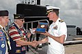 US Navy 070622-N-1522S-014 Fast-attack submarine USS Jacksonville (SSN 699) Commanding Officer, Cmdr. John Kropcho receives a plaque celebrating their visit to Jacksonville, Fla., from the United States Submarine Veterans, Inc.jpg
