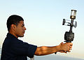 US Navy 080627-N-9604C-031 An aerographer's mate uses a hand held anemometer to check wind direction and speed from the flight deck aboard the amphibious assault ship USS Peleliu (LHA 5).jpg