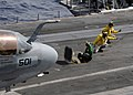 US Navy 080728-N-7241L-124 Flight deck shooters give the signal to launch an EA-6B Prowler assigned to the.jpg