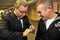US Navy 081117-N-5758H-399 ESPN sports analyst Ron Jaworski, left, shows his Super Bowl ring to Engineman 1st Class Brad Vincent, assigned to the littoral combat ship USS Freedom (LCS 1), during a Monday Night Football game.jpg