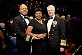 US Navy 090221-N-8273J-081 Cmdr. Roger Isom and wife, Lisa, pose for a photo with Chief of Naval Operations Adm. Gary Roughead at the conclusion of the 2009 Black Engineer of the Year Awards.jpg
