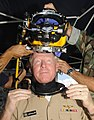 US Navy 090911-N-7498L-021 Adm. Robert Willard, commander, U.S. Pacific Fleet, dons diving headgear after presenting Mobile Diving and Salvage Unit (MDSU) 1 the Meritorious Unit Commendation award at Naval Station Pearl Harbor.jpg