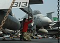 US Navy 091017-N-7191M-033 Aviation Ordnanceman Airman Apprentice Nathaniel Corron cleans a pylon on an F-A-18C Hornet.jpg