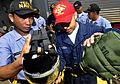 US Navy 091019-N-0807W-114 Damage Controlman Fireman Matthew C. Barrera, assigned to the amphibious dock landing ship USS Harpers Ferry (LSD 49), shows Philippine sailors how to attach a canteen to an MCU-2P gas mask.jpg