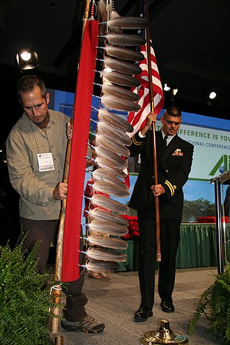 Eagle feather law - Former NASA astronaut John Herrington, left, presents the Eagle Staff while Lt. Ken Vargas, right, presents the American flag during the presentation of colors at the opening ceremony of the 2009 American Indian Science and Engineering Society National Conference at the Oregon Convention Center in Portland. Herrington is a member of the Chickasaw Nation and Vargas is a member of the Choctaw Nation of Oklahoma.