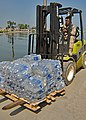 US Navy 100205-N-9643W-328 A Sailor moves bottles of water to be distributed in Killick, Haiti.jpg