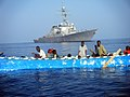 US Navy 100329-N-0008P-023 The guided-missile destroyer USS McFaul (DDG 74) conducts a rescue operation for 29 Somali men and women on a drifting skiff during a routine patrol.jpg