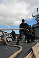 US Navy 100706-N-7200S-033 Sailors haul in mooring lines during sea and anchor detail aboard the guided-missile frigate USS McClusky (FFG 41) while getting underway for Rim of the Pacific (RIMPAC) 2010.jpg