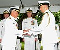 US Navy 100709-N-3666S-026 A Sailor presents Rear Adm. Michael Giorgione with a flag during a change of command ceremony at Commander, U.S. Pacific Fleet Headquarters.jpg