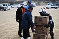 US Navy 110315-N-IC111-652 Naval Air Crewman 2nd Class Zack DelCorte stacks boxes of food for Japanese citizens.jpg